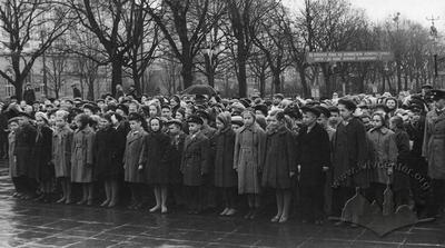 Pupils of school №35 at school assembly near the monument to Lenin on a rainy day
