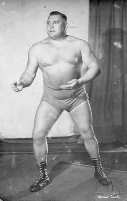 Wrestler in stance poses for an advertising photo