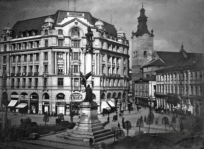 Adam Mickiewicz Monument against the Background of a Multistory Building