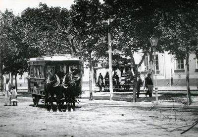 Omnibus and a horse tram on Droga do Dworca street