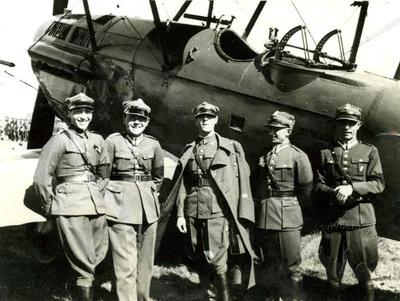 Polish military pilots in front of a plane on the airfield in Sknyliv