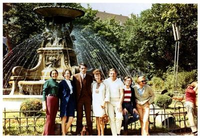 Iryna and Ihor Kalynets with friends near the fountain on Mitskevycha square