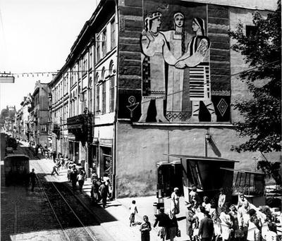 View of Doroshenka Street, and decorative mural on the corner of a building