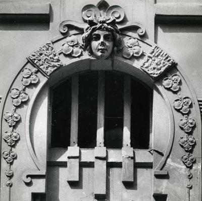Mascaron on the gable at 124 Franka St.