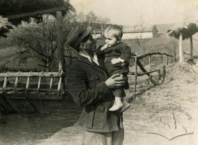 Man with a child on his arms