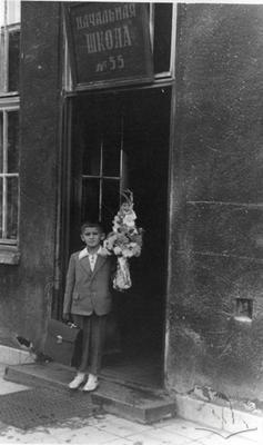 Schoolboy in the door of school