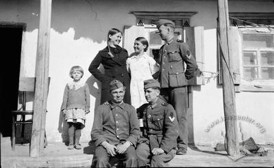 Portrait of German Soldiers with Local Citizens